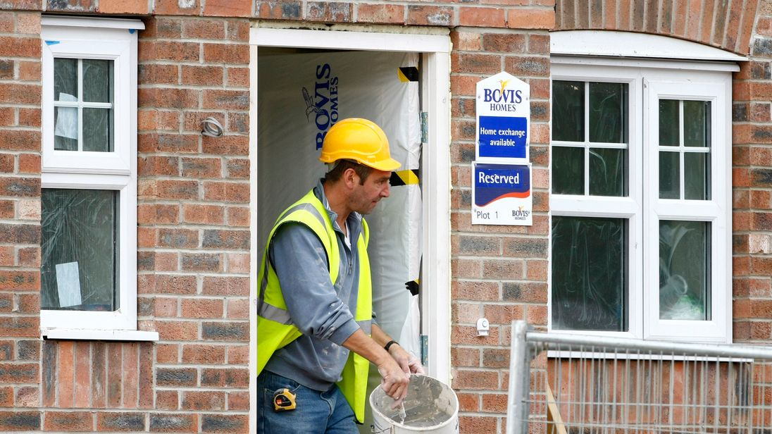 A builder works at a Bovis homes housing development near Bolton, Britain, July 9, 2008.