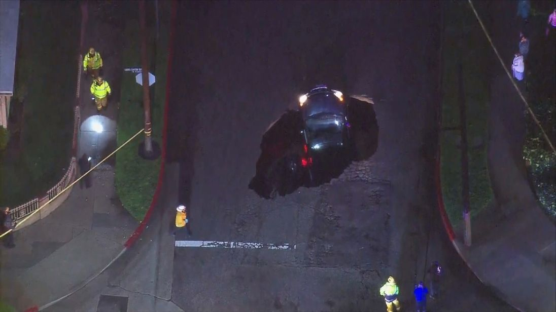 Cars trapped in a pot hole in Los Angeles, CA following heavy rain