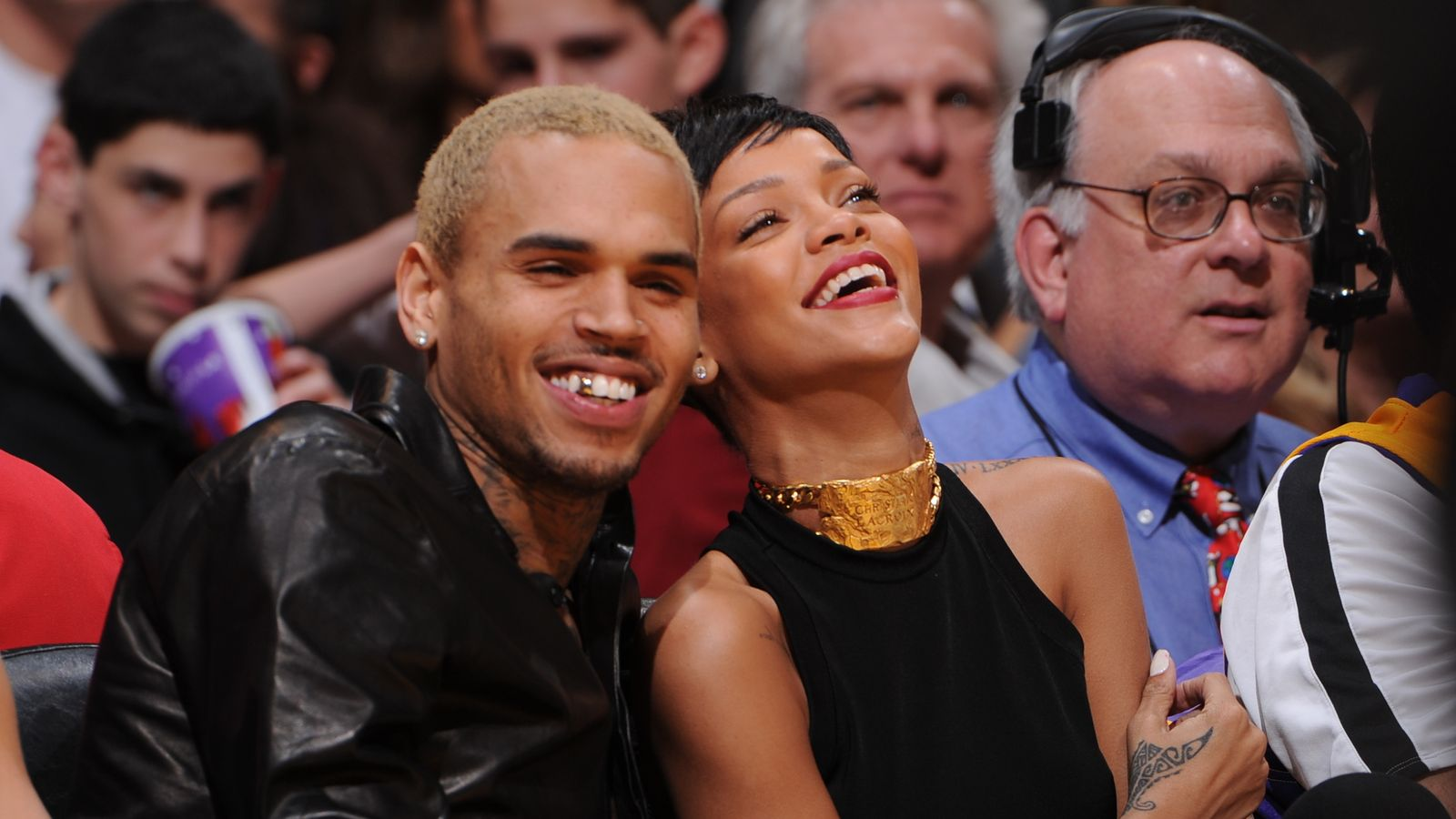 Chris Brown restrained from ex-girlfriend after abuse