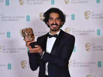 British actor Dev Patel poses with the award for a Supporting Actor for his work on the film 'Lion' at the BAFTA British Academy Film Awards at the Royal Albert Hall in London on February 12, 2017