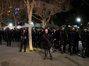 Riot police deploy a skirmish line during the protests