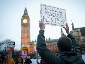Protesters demonstrate outside Parliament where a debate on Trump's state visit is taking place