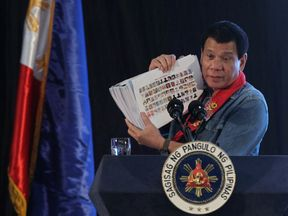 President Duterte shows pictures of people involved in drugs