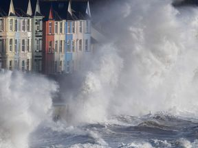 Waves hit the seawall at Dawlish during heavy seas and high winds