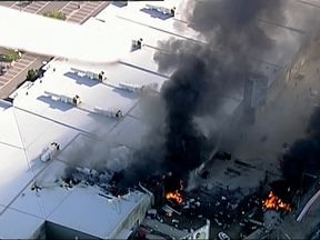 A plane carrying five people has crashed into a shopping centre in northern Melbourne