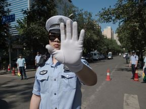 A police officer blocks a road in Beijing