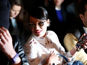 British singer Lily Allen is pictured at the front row during the presentation of the House of Holland Autumn/Winter 2014 collection during London Fashion Week February 15, 2014