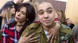 Elor Azaria sits with his mother as his sentencing hearing in Tel Aviv begins