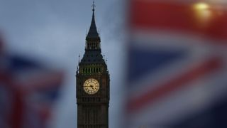 Union flags fly near the The Elizabeth Tower, commonly known Big Ben, and the Houses of Parliament in London on February 1, 2017