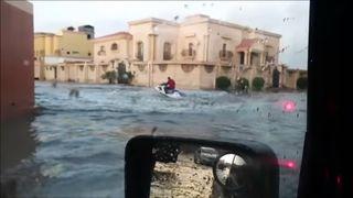 Local in Saudi Arabia takes to his jetski to navigate flooded village