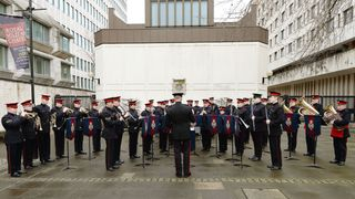 The Grenadier Guards Band practice their musical sequence that was meant to be played at the changing the Guard ceremony outside Buckingham Palace, but which was changed to Wellington Barracks close by because of the weather, in Westminster central London