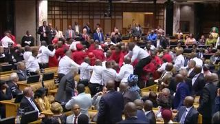 South African Economic Freedom Fighters party brawl in parliament with orderlies