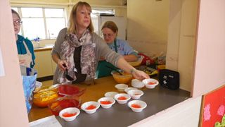 A helper at a the Make Lunch project at St Luke's in Barton Hill, Bristol.