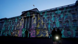 A projection designed by Studio Carrom, the Bangalore and London-based design studio, of a peacock and dancing figures on the facade of Buckingham Palace, London, as a reception to mark the launch of the UK-India Year of Culture 2017 takes place.
