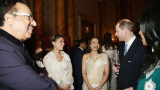 The Earl of Wessex (left) speaks to Ayesha Dharker (centre) during a reception to mark the launch of the UK-India Year of Culture 2017 at Buckingham Palace, London