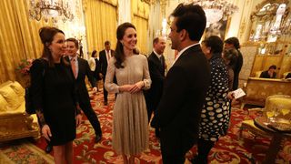 Duchess of Cambridge (centre) speaks to chef Vikas Khanna (right), who is one of the presenters of MasterChef India, at a reception to mark the launch of the UK-India Year of Culture 2017 at Buckingham Palace, London