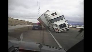 Wind blows truck over on highway in Wyoming. APTN