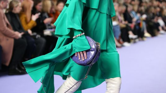 Models present creations by Mulberry during their catwalk show at the Old Billingsgate market