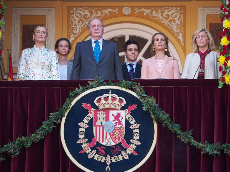 Princess Cristina appears alongside her brother King Juan Carlos during the summer