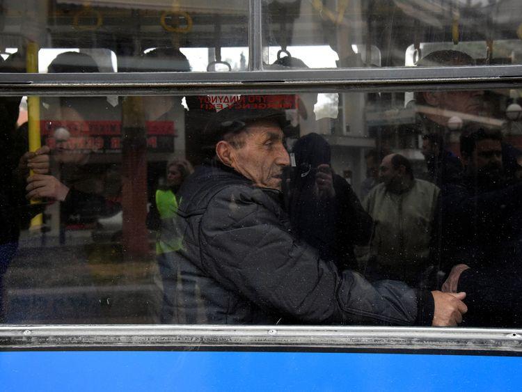 People on an evacuation bus in Thessaloniki