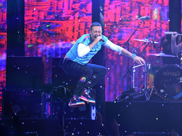 Chris Martin from Coldplay performs with The Chainsmokers