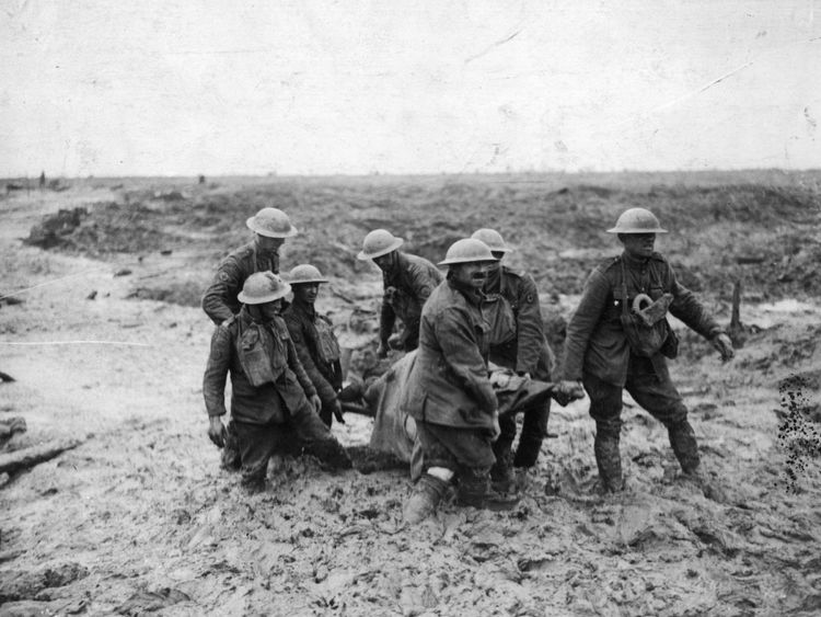 A wounded soldier is carried through mud during the Battle of Passchendaele