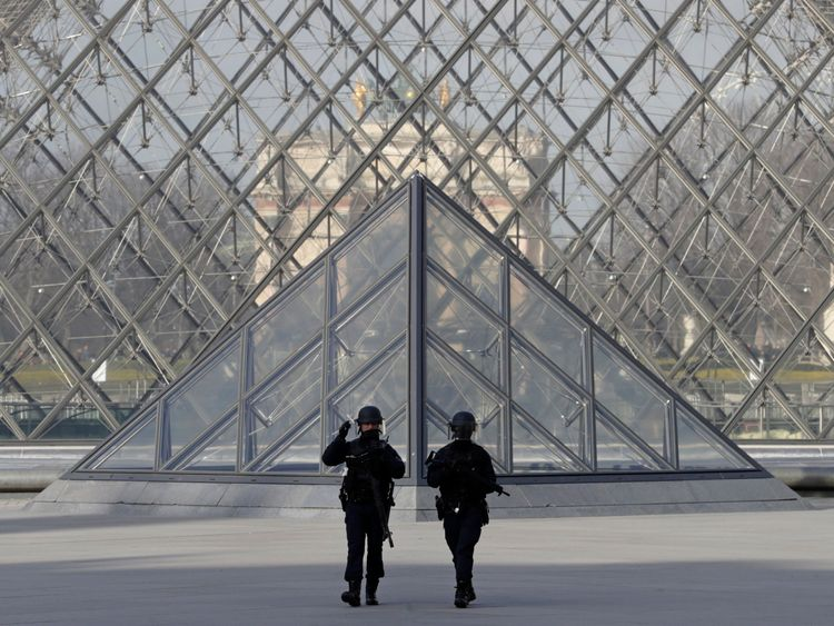 Armed police secure the area in front of the Louvre in Paris after what has been called a 'terrorist incident'