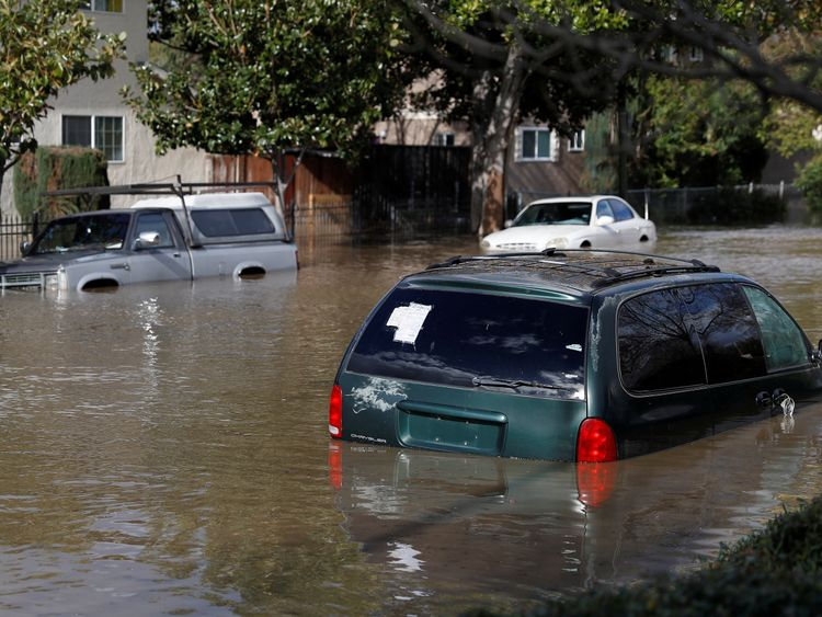 Vehicles in flood water in San Jose, California