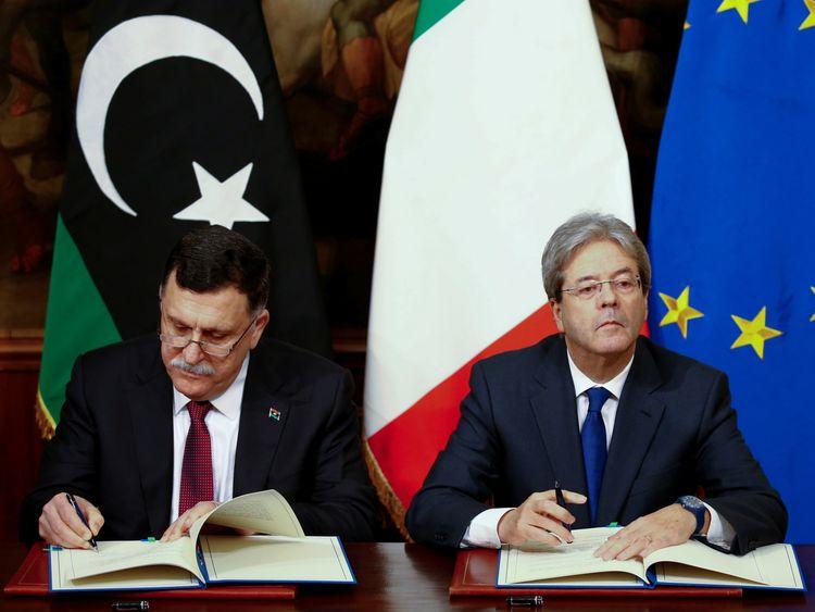 Fayez al-Sarraj and his Italian counterpart Paolo Gentiloni sign a bilateral agreement