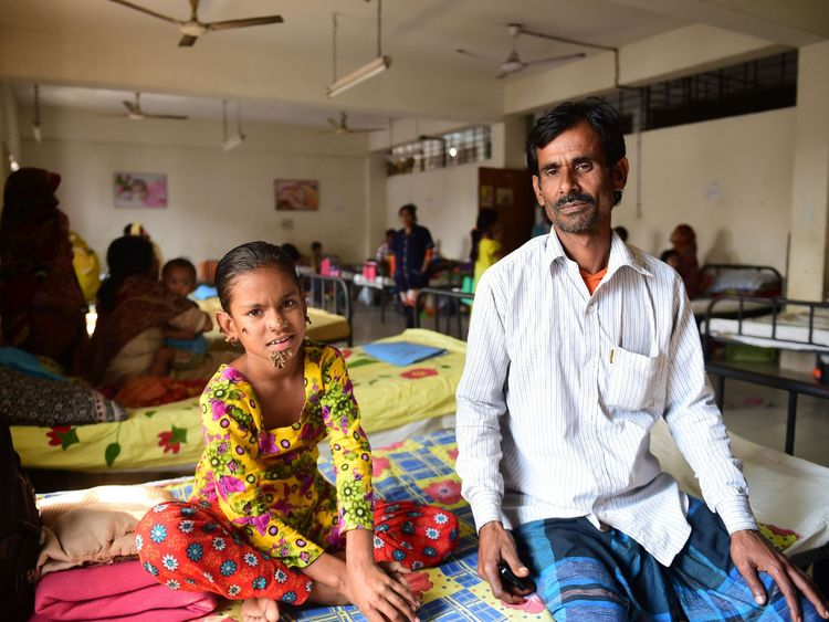 Bangladeshi girl Sahana Khatun, 10, and her father Mohammad Shahjahan
