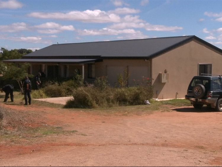 Police sweeping the property in Young. Pic: Australian Federal Police