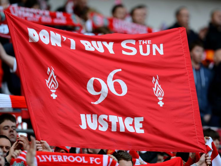 A banner held aloft by Liverpool fans during a match against Everton