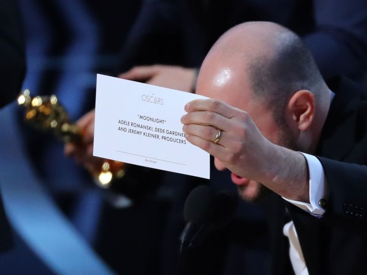 In case anyone was in doubt... the card for best picture winner is held up by Moonlight's producer