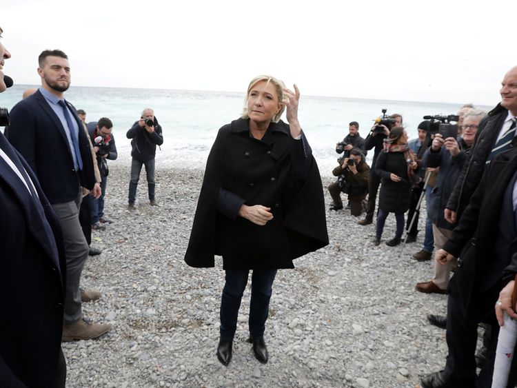 The Front National leader used the visit to attack the government
