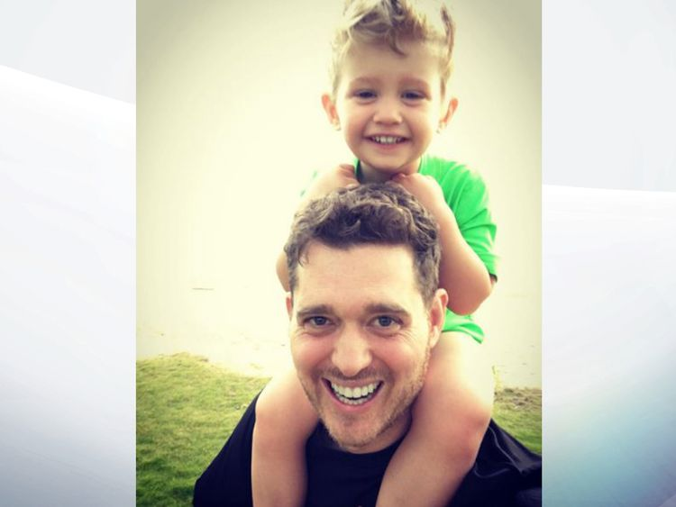Tearful Buble brings son on stage during comeback