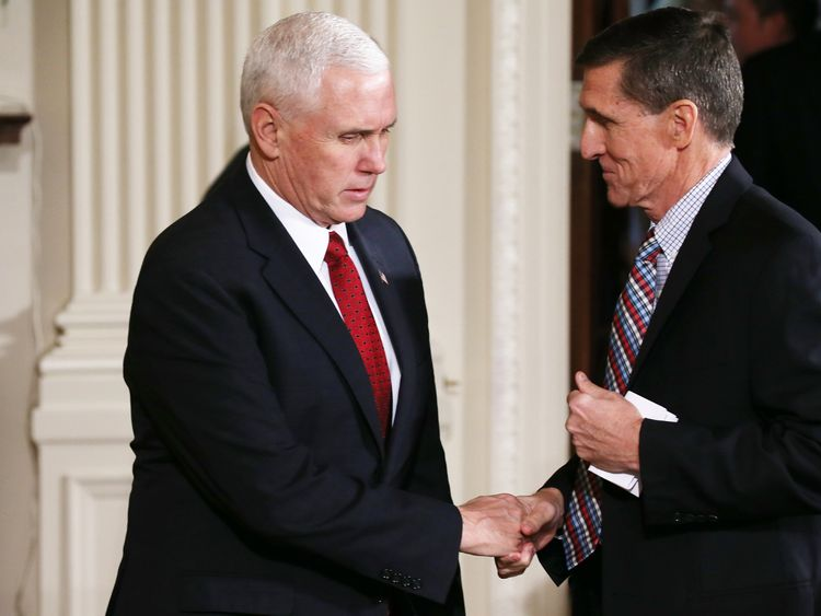 Mike Pence (L) went on TV to defend Michael Flynn