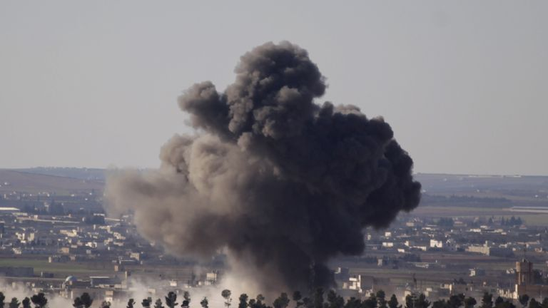 Smoke rises from the northern Syrian town of al-Bab