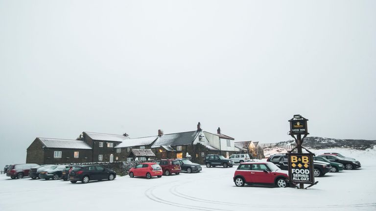 Motorists brave the snow at the Lion Inn in the North York Moors National Park