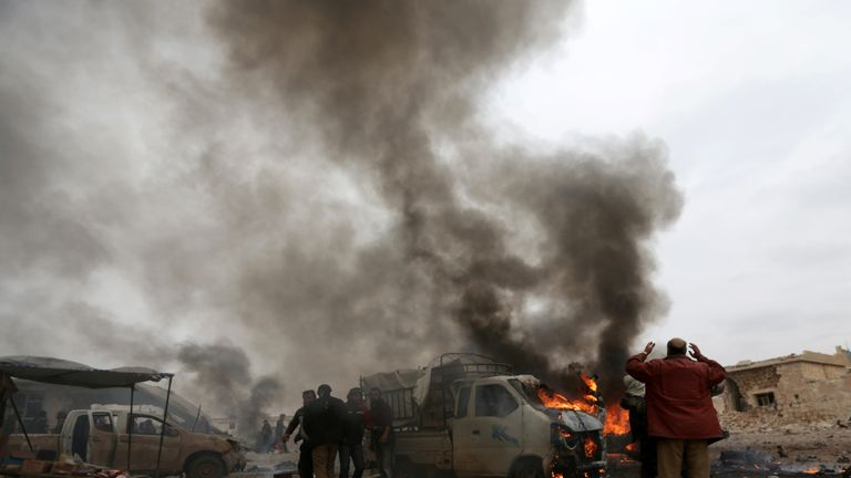 Smoke rises after a car bomb explosion in Jub al Barazi east of the northern Syrian town of al-Bab