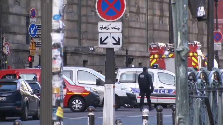 Police vehicles outside the Louvre