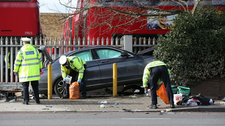 The car's boot popped open on impact, leaving debris strewn across the road