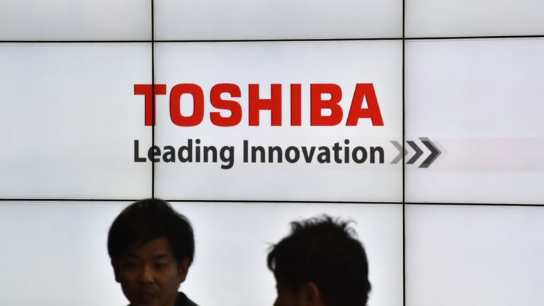 The logo of Japan's Toshiba Corp. is displayed at the company's headquarters in Tokyo on January 27, 2017. Toshiba said on January 27 it will spin off its memory chip business, following reports that the vast conglomerate is planning to sell a stake in the unit to repair its battered balance sheet