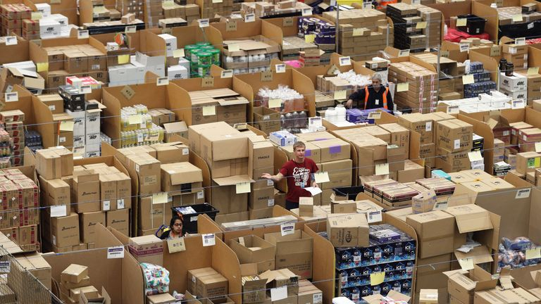 Parcels are processed and prepared for dispatch at Amazon's fulfilment centre in Peterborough