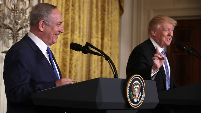 Donald Trump and Bejamin Netanyahu share a joke during their news conference in the White House