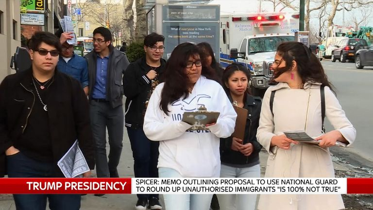 Teenager hand out flyers in new york about immigration raids