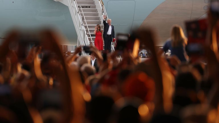 US President Donald Trump and First Lady Melania Trump arrive for a rally on February 18, 2017 in Melbourne, Florida