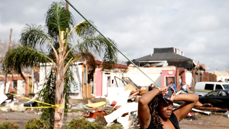 A woman looks at the wreckage caused by a tornado wich touched down along Chef Menture Avenue on February 7, 2017 in New Orleans, Louisiana