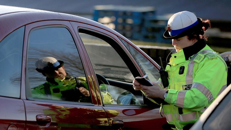 Police during a campaign to raise awareness of the dangers of using a mobile whilst driving