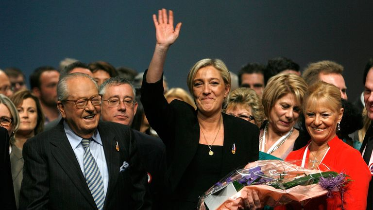 Marine Le Pen, flanked by her father, is named leader of the National Front in 2011