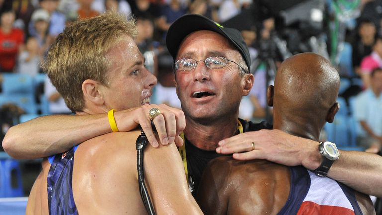 US coach Alberto Salazar (C) hugs Britain's Mo Farah (R) and US athlete Galen Rupp (L) following the men's 5,000 metres final at the International Association of Athletics Federations World Championships in Daegu on September 4, 2011